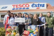 Horley Lions Club receive £500 following Tesco Extra re-launch